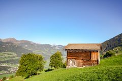 Alpine pasture hike to an old wooden barn with mountain meadow in the austrian alps, Zillertal Austria Europe. Alpine pasture hike to an old wooden barn with royalty free stock photography