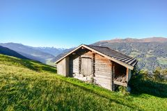 Alpine pasture hike to an old wooden barn with mountain meadow in the austrian alps, Zillertal Austria Europe. Alpine pasture hike to an old wooden barn with stock photography