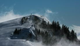 Alpine peak. In fog with hiker on top Royalty Free Stock Photos