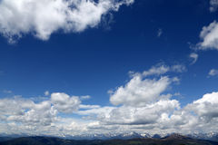 Alpine peak with blue sky and clouds Royalty Free Stock Images