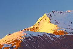 Alpine peak at sunset Royalty Free Stock Image