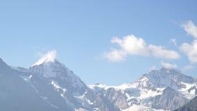 Alpine peaks landscape background. Jungfrau, Bernese highland. Alps, tourism and adventure hiking concept. Alpine peaks landscape background. Jungfrau, Bernese stock video footage