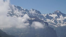 Alpine peaks landskape background. Jungfrau, Bernese highland. Alps, tourism and adventure hiking concept. Alpine peaks landskape background. Jungfrau, Bernese stock footage