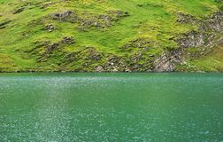 Alpine peaks landskape background. Bachalpsee lake, Grindelwald, Bernese highland. Alps, tourism, journey, hiking stock photo
