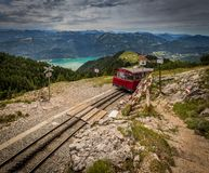 Alpine rack railway track to Schafberg, where steam train takes tourists on a mountain peak in the Austrian Alps near Salzburg stock photography