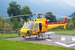 Alpine rescue helicopter on the ground stock photo