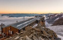 Alpine resort at sunset. Royalty Free Stock Images