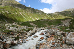 Alpine river. View of alpine mountain river in Switzerland stock photography