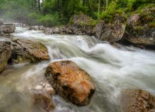 Alpine river. Wild rapids and spray on an alpine river Stock Photo