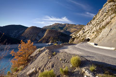 Alpine road along the coast of a lake Stock Image