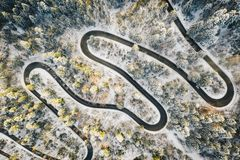 Alpine road in extreme winter weather conditions. Aerial winter image of a winding road in the mountains shot with a high resolution drone royalty free stock photography