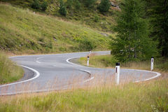 Alpine road. Great curves at mountain road Royalty Free Stock Photo
