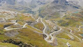 Alpine road 4k. Beautiful alpine panorama with mountain road stock video