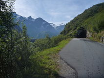 Alpine road with a  mountain panorama Stock Image