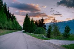 Alpine road at sunset stock photo