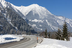 Alpine road in winter scenery Royalty Free Stock Photos