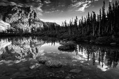 Alpine Rocky Mountain Reflection. This image was taken just after sunrise from Lake Helene - after a hike up from the Bear Lake trailhead in Rocky Mountain Royalty Free Stock Images