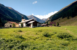 Alpine rural scene seen from a rocky ridge. Hiking in Swiss Alps. Royalty Free Stock Images