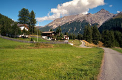 Alpine rural scene seen from a rocky ridge. Hiking in Swiss Alps. Royalty Free Stock Image