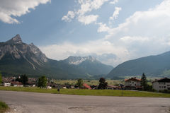 Alpine scene with a road in the foreground Royalty Free Stock Photo