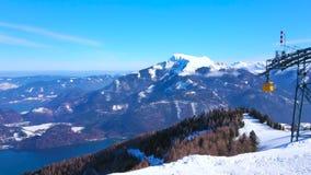 Alpine scenery from the top of Zwolferhorn, St Gilden, Salzkammergut, Austria. Watch the snowy Alpine scenery from the top of Zwolferhorn Mount with riding stock video