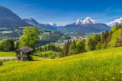 Alpine scenery with traditional mountain chalet in summer royalty free stock image
