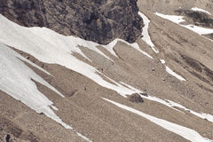Alpine screed with a permanent snowfield Stock Photo