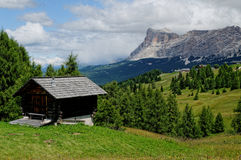 Alpine shelter and meadows Royalty Free Stock Image
