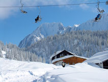 Alpine Ski Lift. Ski Lift and alpine hut in Austrian snow Royalty Free Stock Photography