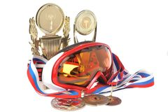 Alpine ski mask, cups and medals  on white Stock Image