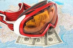 Alpine ski mask with money on map Royalty Free Stock Images