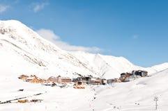 Alpine ski resort village. Alpine village and ski resort in winter Royalty Free Stock Photos