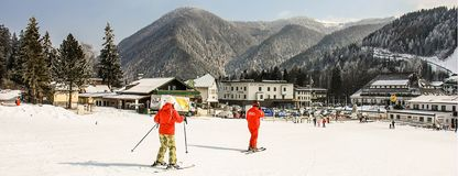 Alpine ski school. Instructor and student in colorful ski equipment stock images