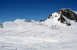 Alpine ski slope and skiers Royalty Free Stock Image