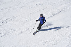 Alpine skier. Alpine or downhill skier in prepared skisloope or piste. Gaschurn, Austria, Europe Stock Image