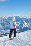 Alpine skier mountains in the background Stock Photo