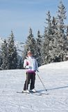 Alpine skier mountains in the background Stock Image