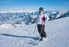 Alpine skier mountains in the background Stock Photography
