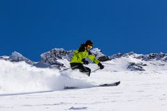 Alpine skier on piste, skiing downhill Royalty Free Stock Photos