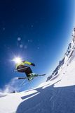 Alpine skier on piste, skiing downhill Royalty Free Stock Photography
