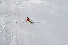 Alpine skier in pisted skisloope. Alpine skier in newpisted skisloope. Gaschurn, Austria Royalty Free Stock Photos