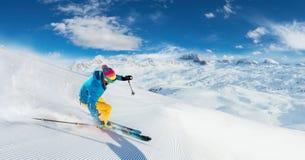 Alpine skier skiing downhill, panoramic format stock image