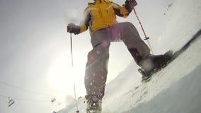Alpine skier skiing short swings on ski slope stock video