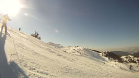 Alpine skier skiing short swings on ski slope stock video footage