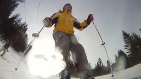 Alpine skier skiing short swings on ski slope stock footage