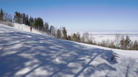 Alpine skiers at hill near Belokurikha stock footage