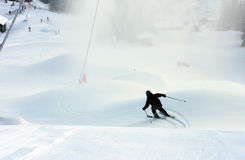 Alpine skiing. Boy skiing fast down the slope stock image
