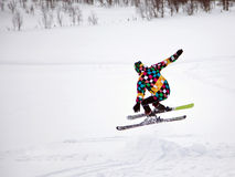 Alpine skiing. Boy jumping with alpine ski royalty free stock photography