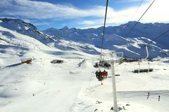 Alpine skiing lift. Winter skiing time and travel in Alps royalty free stock photography