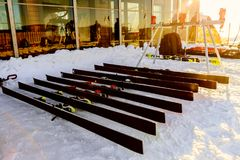 Alpine skis lie on snow next to waxing table. Magnitogorsk, Russia - December 18, 2017: alpine skis lie on snow next to waxing table Royalty Free Stock Images
